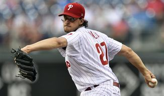 Philadelphia Phillies starting pitcher Aaron Nola winds up during the first inning of the team's baseball game against the Milwaukee Brewers, Friday, July 21, 2017, in Philadelphia. (AP Photo/Derik Hamilton)