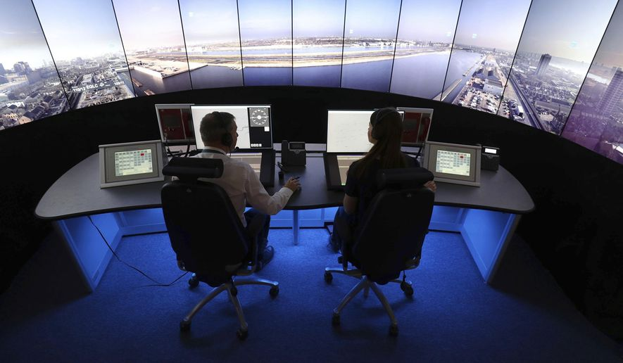 FILE - This is a May 19, 2017  file photo of National Air Traffic Services personnel giving a demonstration in the operations room at National Air Traffic Services in Swanwick southern England. Britain is poised to handle a record number of flights in its increasingly crowded skies. The NATS air traffic control agency said it expects to handle some 8,800 flights Friday, in what is expected to be the peak day of the busy summer travel season. (Andrew Matthews/PA File via AP)
