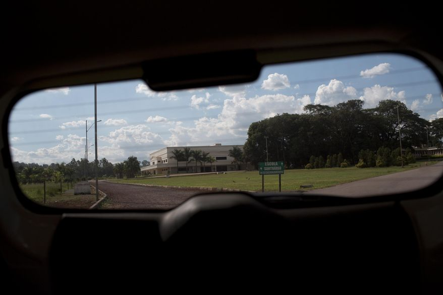 ADVANCE FOR USE MONDAY, JULY 24, 2017 AND THEREAFTER-This Wednesday, March 29, 2017 photo shows the Word of Faith Fellowship church in Sao Joaquim de Bicas, Brazil, through a car window. Over the course of two decades, the U.S.-based mother church took command of this and another congregation in Brazil, applying a strict interpretation of the Bible and enforcing it through rigorous controls and physical punishment. (AP Photo/Silvia Izquierdo)