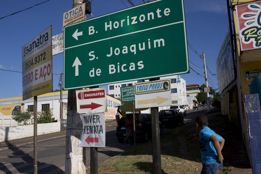 ADVANCE FOR USE MONDAY, JULY 24, 2017 AND THEREAFTER-This Wednesday, March 29, 2017 photo shows a road sign pointing to Sao Joaquim de Bicas, Brazil, a small city about a 45-minute drive from Belo Horizonte. Over the course of two decades, Word of Faith Fellowship absorbed two churches in Brazil, in the southeastern cities of Sao Joaquim de Bicas and Franco da Rocha. (AP Photo/Silvia Izquierdo)