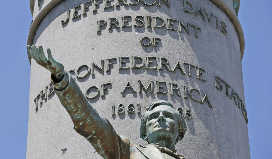 This Wednesday, June 28, 2017, photo shows statue of Confederate president Jefferson Davis on Monument Avenue in Richmond, Va. As cities across the United States are removing Confederate statues and other symbols, dispensing with what some see as offensive artifacts of a shameful past marked by racism and slavery, Richmond is taking a go-slow approach. (AP Photo/Steve Helber) **FILE**