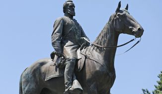 This Wednesday, June 28, 2017, shows the statue of Confederate Gen. Stonewall Jackson on Monument Avenue in Richmond, Va. As cities across the United States are removing Confederate statues and other symbols, dispensing with what some see as offensive artifacts of a shameful past marked by racism and slavery, Richmond is taking a go-slow approach. (AP Photo/Steve Helber)