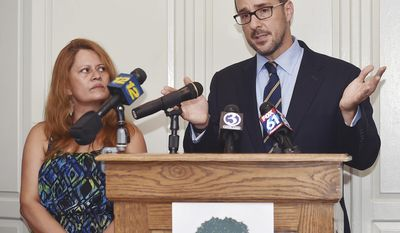 In this Wednesday, July 19, 2017 photo, attorney Glenn Formica speaks at a press conference   New Haven, Conn., for Nury Chavarria, left, a housekeeper and mother of four who was scheduled to be deported the following day. U.S. immigration officials said Friday, July 21, 2017,  they consider Chavarria, who is trying to avoid deportation by seeking sanctuary in a Connecticut church, to be a fugitive, but acknowledge they have a policy that restricts them from entering a house of worship except in extraordinary circumstances.(Catherine Avalone/New Haven Register via AP)