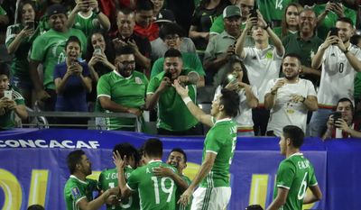 Mexico's Rodolfo Pizarro celebrates with his teammates after he scored his team's first goal against Honduras, during a CONCACAF Gold Cup quarterfinal soccer match, Thursday, July 20, 2017, in Glendale, Ariz. (AP Photo/Matt York)
