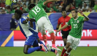 Honduras' Alberth Elis, left, heads the ball with Mexico's Jesus Gallardo (18) as Mexico's Jesus Duenas looks on during a CONCACAF Gold Cup quarterfinal soccer match, Thursday, July 20, 2017, in Glendale, Ariz. (AP Photo/Matt York)