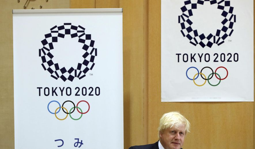 Britain's Foreign Secretary Boris Johnson attends a meeting with Tokyo Gov. Yuriko Koike, at the Tokyo Metropolitan government office in Tokyo Friday, July 21, 2017. Johnson arrived in Tokyo earlier Thursday for talks on security and trade, and to share his experience of hosting the Olympics as London mayor five years ago. (AP Photo/Eugene Hoshiko)