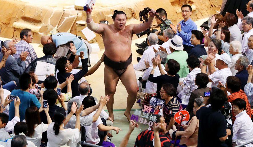 Mongolian grand champ Hakuho sets record 1,048 wins in sumo