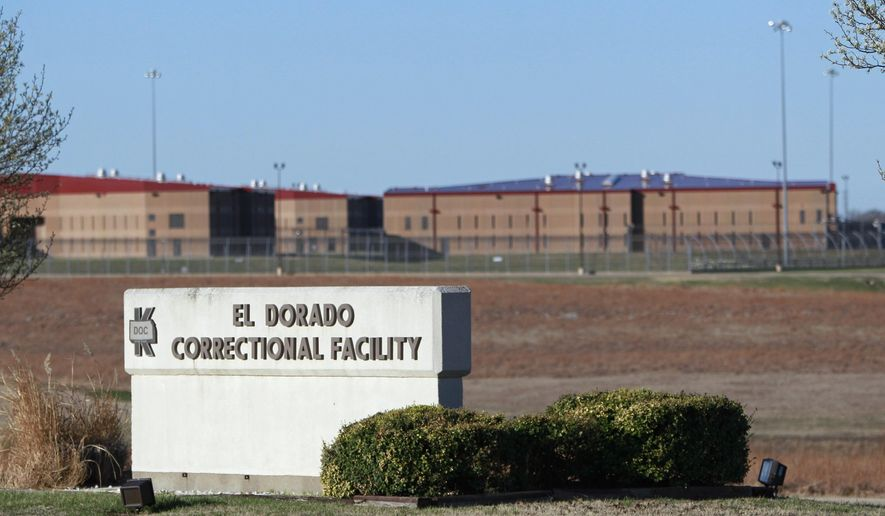 FILE - This March 23, 2011, photo shows the El Dorado Correctional Facility near El Dorado, Kan. A union representing state employees disclosed Friday, July 21, 2017, it filed a grievance earlier this month with Kansas' top corrections officials alleging that officers at the maximum-security prison are being forced to work 16-hour shifts. (AP Photo/Orlin Wagner, File)
