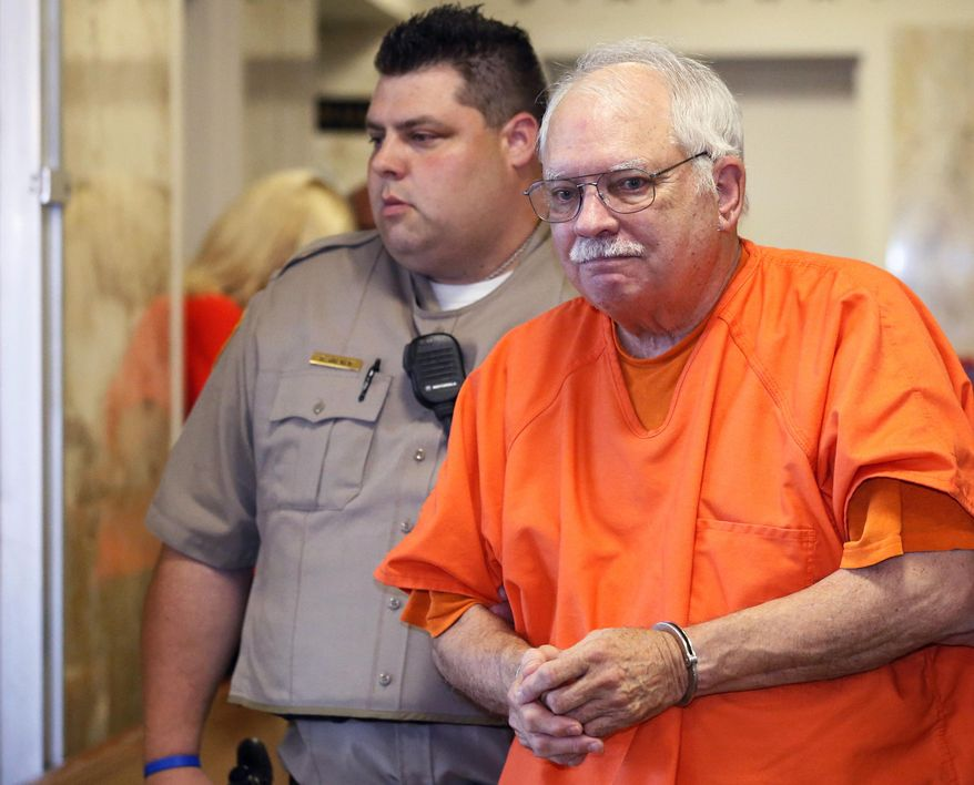 """FILE - In this May 31, 2016, file photo, Robert Bates, a former Tulsa County volunteer sheriff's deputy who fatally shot an unarmed black man in 2015, is escorted from the courtroom after being sentenced in Tulsa, Okla. According to a federal lawsuit filed Thursday, July 20, 2017, then-Tulsa County Sheriff Stanley Glanz forced Tulsa County Sheriff's Maj. Tom Huckeby to """"take the hit"""" and resign following the shooting. (AP Photo/Sue Ogrocki, File)"""
