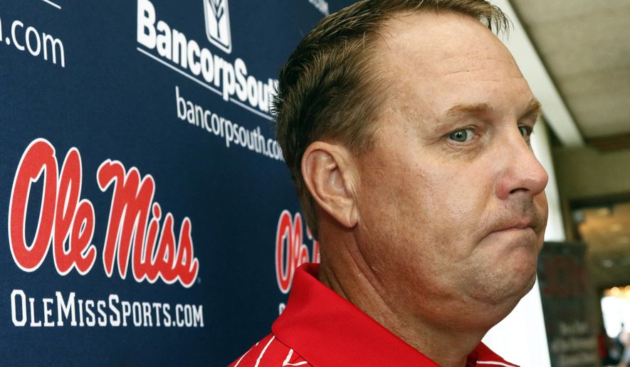 In this Tuesday, July 18, 2017 photo, Mississippi football coach Hugh Freeze considers a response to a question as he speaks to reporters during a Rebel Road Trip to visit with alumni and athletic supporters in Jackson, Miss. Mississippi announced Thursday, July 20, that Freeze resigned after five seasons, bringing a stunning end to a once-promising tenure. Offensive line coach Matt Luke has been named interim coach. (AP Photo/Rogelio V. Solis)