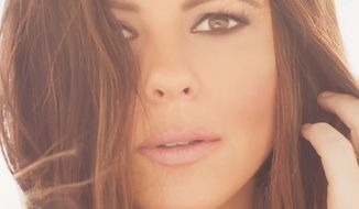 "This cover image released by Born to Fly Records shows ""Words,"" a new release by Sara Evans. (Born to Fly Records via AP)"