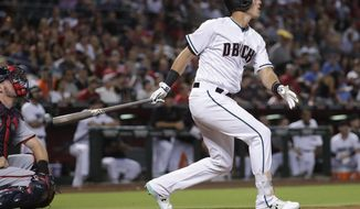 Arizona Diamondbacks' Jake Lamb follows through on a solo home run against the Washington Nationals during the first inning of a baseball game, Friday, July 21, 2017, in Phoenix. (AP Photo/Matt York)