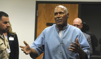 Former NFL football star O.J. Simpson reacts after learning he was granted parole at the Lovelock Correctional Center in Lovelock, Nev., on Thursday, July 20, 2017. Simpson was granted parole Thursday after more than eight years in prison for a Las Vegas hotel heist, successfully making his case in a nationally televised hearing that reflected America's enduring fascination with the former football star. (Jason Bean/The Reno Gazette-Journal via AP, Pool)