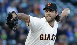 San Francisco Giants starting pitcher Madison Bumgarner works in the first inning of the team's baseball game against the San Diego Padres on Thursday, July 20, 2017, in San Francisco. (AP Photo/Eric Risberg)
