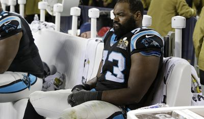 """FILE - In this Feb. 7, 2016, file photo, Carolina Panthers' Michael Oher watches from the bench during the second half of the NFL Super Bowl 50 football game in Santa Clara, Calif. The Panthers released the former starting left tackle — the subject of the movie """"The Blind Side"""" — after he failed a physical on Thursday, July 20, 2017. The move comes six days before the Panthers are scheduled to report to training camp and 10 months since Oher last played. Oher started 16 regular games and three playoff games for the Panthers during their Super Bowl run in 2015. (AP Photo/Marcio Jose Sanchez, File)"""