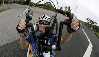 In this Thursday, June 8, 2017 photo, Beth Sanden trains for a marathon on her hand cycle in San Clemente, Calif. During a bike training accident for an Ironman competition Sanden became partially paralyzed and now helps other triathletes with similar injuries train. (AP Photo/Chris Carlson)