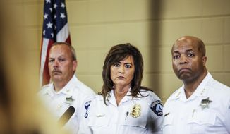 Minneapolis police chief Janee Harteau, center, stands with police inspector Michael Kjos, left, and assistant chief Medaria Arradondo during a news conference Thursday, July 20, 2017, Minneapolis. It was the first time she appeared publicly since the police shooting death of Justine Damond on Saturday. (Maria Alejandra Cardona/Minnesota Public Radio via AP)