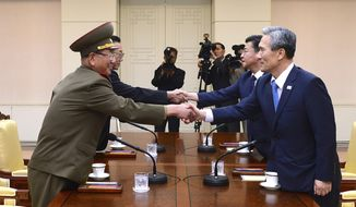 FILE - In this Aug. 22, 2015 file photo provided by the South Korean Unification Ministry, South Korean National Security Director, Kim Kwan-jin, right, and Unification Minister Hong Yong-pyo, second from right, shake hands with Hwang Pyong So, left, North Korea' top political officer for the Korean People's Army, and Kim Yang Gon, a senior North Korean official responsible for South Korean affairs, during their meeting at the border village of Panmunjom in Paju, South Korea. ISouth Korea has urged North Korea to accept its offers for talks as Pyongyang continues to ignore Seoul's proposal for a military meeting to ease animosities along their tense border. (The South Korean Unification Ministry via AP, File)