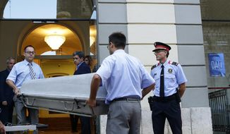 Workers bring a casket to the Dali Theater Museum in Figueres, Spain, Thursday, July 20, 2017. Salvador Dali's eccentric artistic and personal history took yet another bizarre turn Thursday with the exhumation of his embalmed remains in order to find genetic samples that could settle whether one of the founding figures of surrealism fathered a daughter decades ago. (AP Photo/Manu Fernandez)