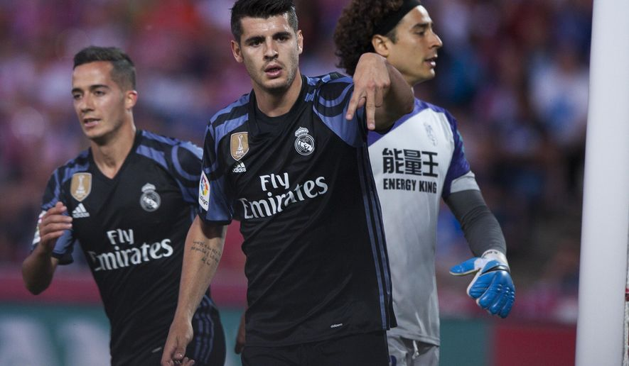 FILE - A Saturday May 6, 2017 file photo of Real Madrid's Alvaro Morata, center, celebrating scoring his goal against Granada during a Spanish La Liga soccer match between Granada and Real Madrid in Granada, Spain. Chelsea is set to strengthen its attacking options for its Premier League title defense by signing Alvaro Morata from Real Madrid. The London club said Wednesday, July 19, 2017, it has agreed terms with Madrid to sign the 24-year-old striker. (AP Photo/Daniel Tejedor, File)