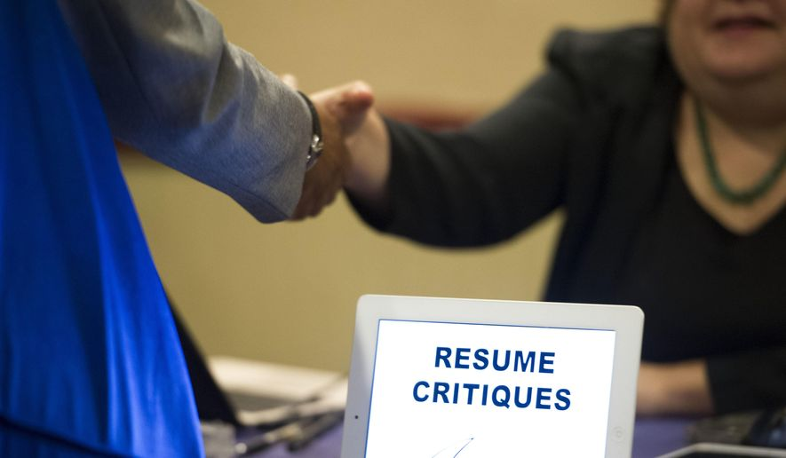 FILE - In this Thursday, May 30, 2013, file photo, a job seeker stops at a table offering resume critiques during a job fair held in Atlanta. On Friday, July 21, 2017, the Labor Department reports on state unemployment rates for June. (AP Photo/John Amis, File)