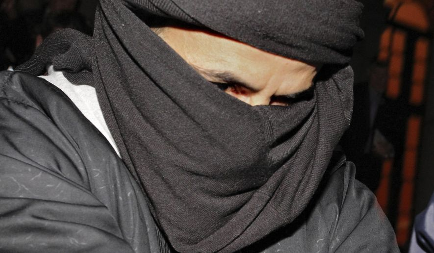 FILE – In this March 15, 2010, file photo, Ali Charaf Damache arrives at the courthouse in Waterford, Ireland. Damache, an al-Qaida suspect known as Black Flag who has been linked to a plot to kill Swedish cartoonist Lars Vilks, appeared in federal court in Philadelphia on Friday, July 21, 2017, after he was brought from Spain to face terrorism charges. (AP Photo/Peter Morrison, File)
