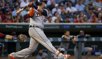 Detroit Tigers' Victor Martinez watches his two-run home run leave the park against the Minnesota Twins in the fourth inning of a baseball game Friday, July 21, 2017, in Minneapolis. (AP Photo/Bruce Kluckhohn)