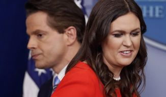 Sarah Huckabee Sanders who has been named White House press secretary and incoming White House communications director Anthony Scaramucci pass each other by the podium during the press briefing in the Brady Press Briefing room of the White House in Washington, Friday, July 21, 2017. (AP Photo/Pablo Martinez Monsivais)