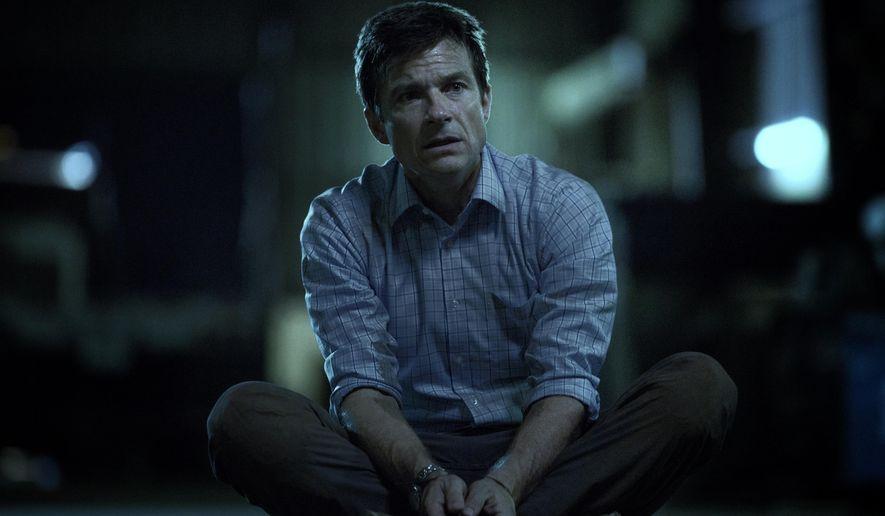 "This image released by Netflix shows Jason Bateman in a scene from the series, ""Ozark."" (Jackson Davis/Netflix via AP)"