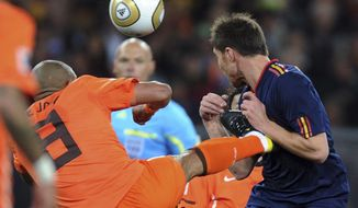 FILE - In this Sunday, July 11, 2010, file photo, Netherlands' Nigel de Jong, left, fouls Spain's Xabi Alonso during the World Cup final soccer match at Soccer City in Johannesburg, South Africa. Howard Webb says he would have given De Jong a red card in the 2010 World Cup final if a video assistant referee had been in place.The retired English referee showed De Jong a yellow card in the 28th minute for his karate kick into the chest of Alonso. (AP Photo/Daniel Ochoa de Olza, File)