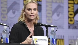"Charlize Theron speaks at the ""Women Who Kick Ass"" panel on day three of Comic-Con International on Saturday, July 22, 2017, in San Diego. (Photo by Richard Shotwell/Invision/AP)"