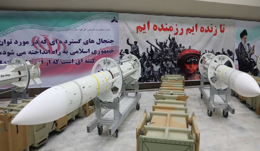 """This picture released by the official website of the Iranian Defense Ministry on Saturday, July 22, 2017, shows Sayyad-3 air defense missiles during inauguration of its production line at an undisclosed location, Iran, according to official information released. Sayyad-3 is an upgrade to previous versions of the missile. Writing on the banner at right reads in Persian: """" We are fighters as long as we are alive"""". (Iranian Defense Ministry via AP)"""