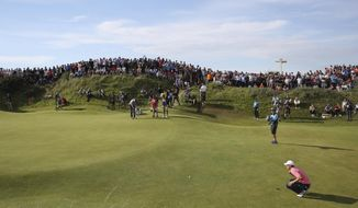 Jordan Spieth of the United States lines up a putt on the 10th hole during the third round of the British Open Golf Championship, at Royal Birkdale, Southport, England, Saturday July 22, 2017. (AP Photo/Peter Morrison)