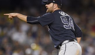 Atlanta Braves starting pitcher Jaime Garcia points toward home after Los Angeles Dodgers' Chris Taylor struck out during the seventh inning of a baseball game in Los Angeles, Friday, July 21, 2017. (AP Photo/Kelvin Kuo)