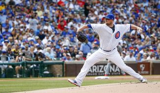 Chicago Cubs starting pitcher Jon Lester delivers against the St. Louis Cardinals during the first inning of a baseball game, Saturday, July 22, 2017, in Chicago. (AP Photo/Kamil Krzaczynski)