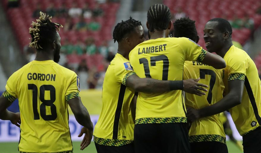 Jamaica players celebrate after Shaun Francis (7) scored his team's first goal against Canada during a CONCACAF Gold Cup quarterfinal soccer match, Thursday, July 20, 2017, in Glendale, Ariz. (AP Photo/Matt York)
