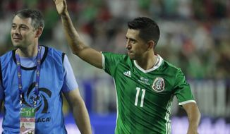 Mexico's Elias Hernandez waves to the fans at the end of a CONCACAF Gold Cup quarterfinal soccer match, Thursday, July 20, 2017, in Glendale, Ariz. Mexico won the match 1-0 and advances to the semifinals. (AP Photo/Matt York)