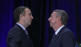 Democratic gubernatorial candidate Lt. Gov. Ralph Northam, left, and GOP gubernatorial candidate Ed Gillespie, shake hands on stage at the Omni Homestead Resort in Hot Springs, Va., Saturday, July 22, 2017.  (Bob Brown/Richmond Times-Dispatch via AP)