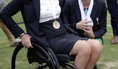 Tennis Hall of Fame inductee Monique Kalkman van den Bosch, left, of the Netherlands, chats with fellow inductee Kim Clijsters, of Belgium, during enshrinement ceremonies at the International Tennis Hall of Fame, Saturday, July 22, 2017, in Newport, R.I. (AP Photo/Elise Amendola)