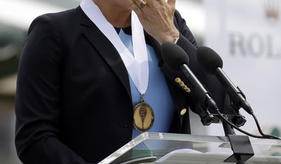 Tennis Hall of Fame inductee Kim Clijsters of Belgium wipes a tear as she speaks during enshrinement ceremonies at the International Tennis Hall of Fame, Saturday, July 22, 2017, in Newport, R.I. (AP Photo/Elise Amendola)