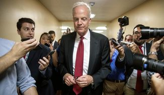FILE - In this July 18, 2017, file photo, U.S. Sen. Jerry Moran, R-Kan. is pursued by reporters as he arrives on Capitol Hill in Washington. Fellow Kansas Sen. Pat Roberts has been working behind the scenes with fellow Republicans on their health overhaul legislation and backing it even as Moran has made national headlines for stalling it. (AP Photo/Andrew Harnik, File)