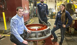 In this Wednesday, July 12, 2017 photo, Steven Jordan, left, Tanner Willman, center, and Jessica White, who have full-time jobs at Northwest Motor Sales & Service pose at the company,  in Longview, Wash. All three got their start by landing paid internships at the company through a new program administered by Goodwill and Workforce Southwest Washington which helps to give local at-risk youth mentorship and exposure to industrial work skills often needed by employers in the area. (Bill Wagner /The Daily News via AP)