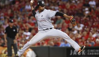 Miami Marlins starting pitcher Jose Urena throws during the first inning of the team's baseball game against the Cincinnati Reds, Friday, July 21, 2017, in Cincinnati. (AP Photo/John Minchillo)