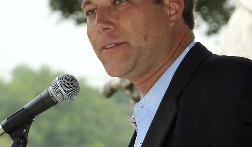 This June 4, 2017 photo provided by Kaper-Dale for Governor shows the Rev. Seth Kaper-Dale, pastor of the Highland Park Reformed Church in New Jersey, at a Medicare rally in Hackensack, N.J. Kaper-Dale is the Green Party candidate for governor in New Jersey. (Kaper-Dale for Governor via AP)