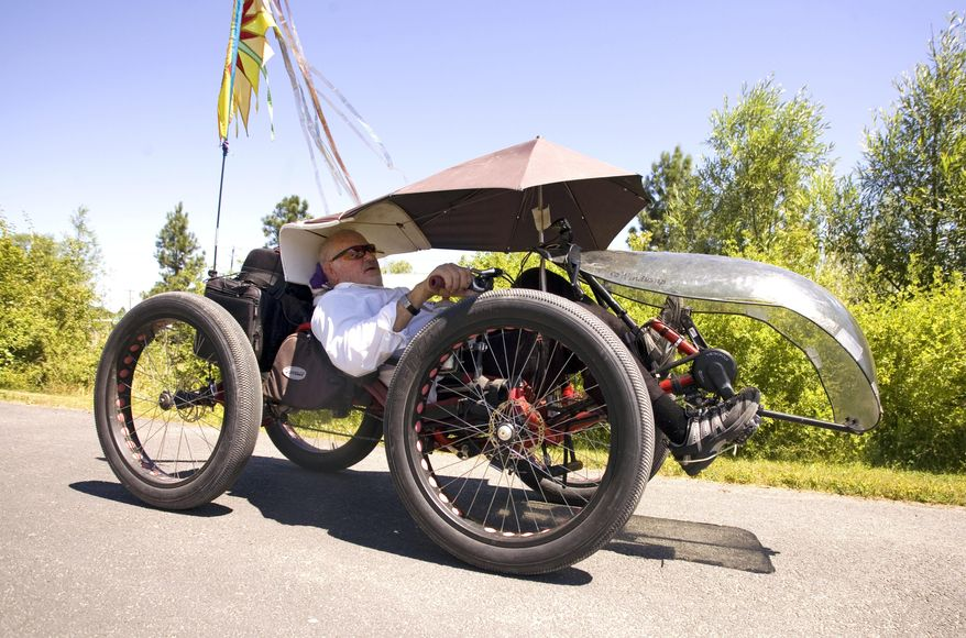 Alfred Allen Rides his fat-tire recumbent quad on a path on Friday, July 14, 2017, in Moscow, Idaho. Allen bought the quad in Aug., 2016, and has added several accessories since then. Allen said the fat tires allow him to ride away from cars on gravel and dirt roads and trails. (Geoff Crimmins/The Moscow-Pullman Daily News via AP)