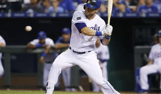 Kansas City Royals' Alex Gordon swings on a two-run double during the fifth inning against the Chicago White Sox in a baseball game at Kauffman Stadium in Kansas City, Mo., Friday, July. 21, 2017. (AP Photo/Colin E. Braley)