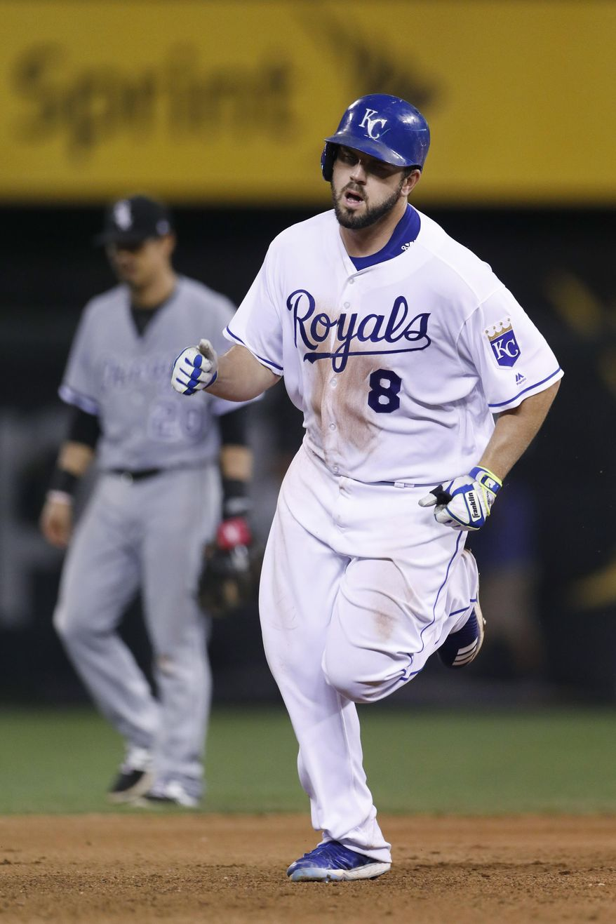 Kansas City Royals' Mike Moustakas rounds the bases after hitting a solo home run during the eighth inning of the team's baseball game against the Chicago White Sox at Kauffman Stadium in Kansas City, Mo., Saturday, July 22, 2017. The home run was Moustakas's second of the night. The Royals defeated the White Sox 7-2. (AP Photo/Colin E. Braley)