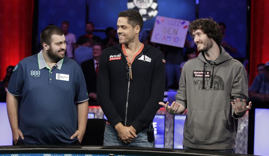 The final three players, from left, Scott Blumstein; Benjamin Pollak, of France; and Dan Ott stand at the final table during the World Series of Poker, Friday, July 21, 2017, in Las Vegas. (AP Photo/John Locher)