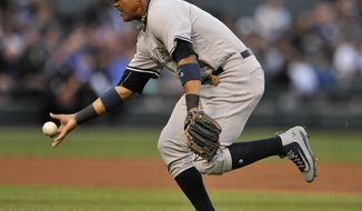 FILE - In this June 26, 2017, file photo, New York Yankees second baseman Starlin Castro bobbles a single hit by Chicago White Sox's Jose Abreu during the first inning of a baseball game in Chicago. Castro will be placed on the disabled list with another injury to his right hamstring, manager Joe Girardi said Saturday, July 22. Castro, activated off the disabled on July 15, reinjured his hamstring while running out a ground ball on Wednesday at Minnesota. He played in the first two games of the series at Seattle on Thursday and Friday with one hit in eight at-bats. (AP Photo/Paul Beaty, File)