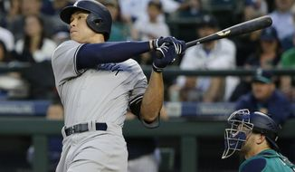 New York Yankees' Aaron Judge watches his three-run home run against the Seattle Mariner during the fifth inning of a baseball game Friday, July 21, 2017, in Seattle. (AP Photo/Ted S. Warren)